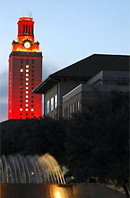 The UT Tower at night lit for the NCAA National Football championship.