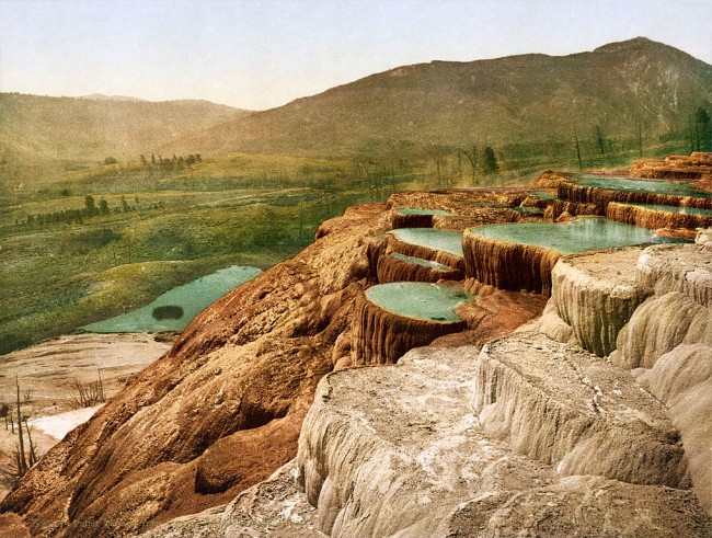 A 1898 photochrom print of Pulpit Terrace at the Mammoth Hot Springs at Yellowstone National Park.