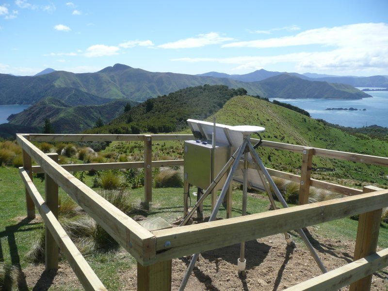 A GPS station overlooking mountains and water