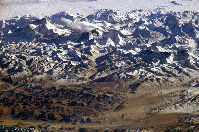 A view of the Himalayan Mountains from the International Space Station. A University of Texas at Austin study found that snow data collected by satellites significantly improved seasonal temperature prediction in the Tibetan Plateau, a region bordered by the Himalayas. NASA