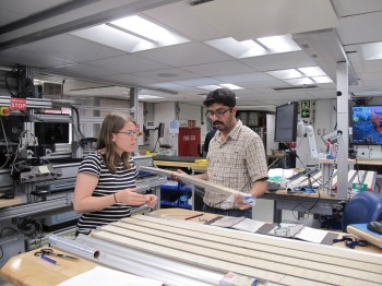 Kaustubh Thirumalai and Kate Littler, a paleoclimatologist at the University of Exeter in the U.K., discuss drill samples. Liping Zhou.
