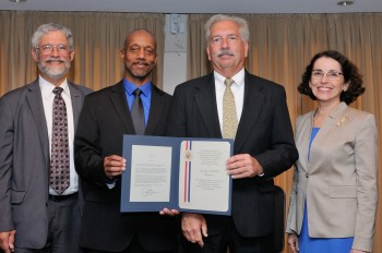 Moore and Ratcliff receive the award from OSTP Director John Holdren and NSF Director France A. Córdova. National Science Foundation.