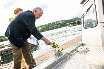 Scott Petty christens the Jackson School's new coastal research vessel.