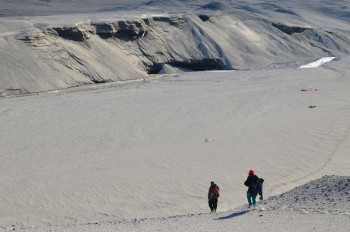 Jackie Watters and Stephen Chignell descend into the Garwood river floodplain to investigate the recently re-exposed massive ice cliff in Garwood valley in Antarctica.