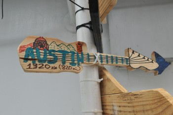 A sign made by Gulick indicating the way to Austin, Texas from the L/B Merida. It joins other signs made by other research scientists on the Myrtle.