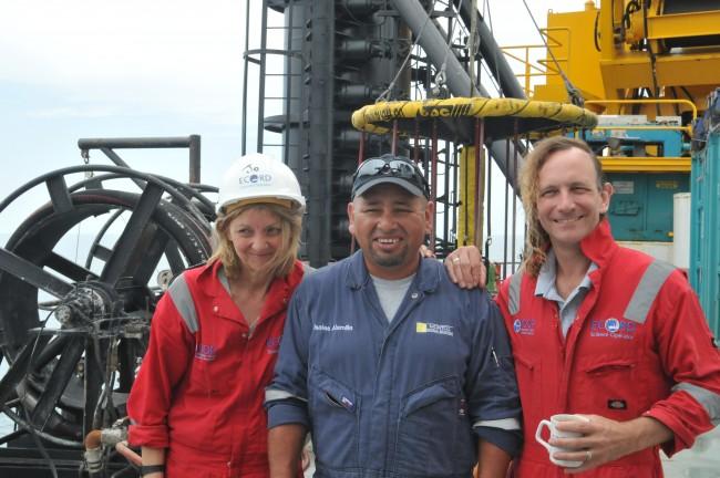 Co-principal investigators Joanna Morgan and Sean Gulick with L/B Myrtle crew member Isaias Alamilla (middle)