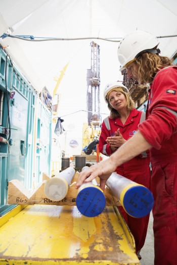 C0-cheifs Joanna Morgan (left) and Sean Gulick examine core samples.
