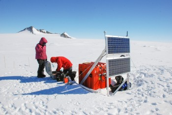 Researchers work with the HOWD PoleNet seismic station in Antarctica's Howard Nunataks.