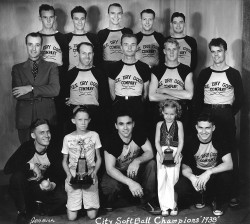 Jack (top row, second from right) with softball team.