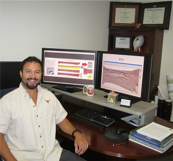 Andrew Hartwig with seismic data.