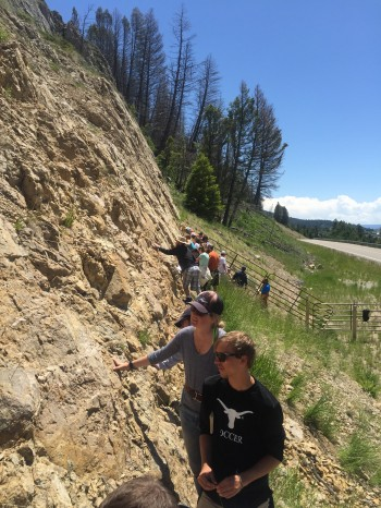 Conner Everts and assistant instructor Meredith Bush examining the fault scarp of the 1959 Hebgen Lake Earthquake in southwest Montana.