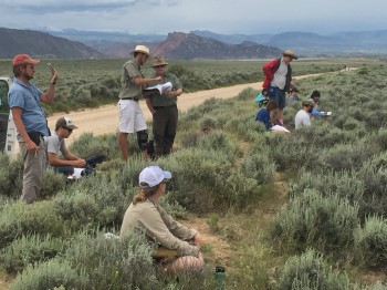Professor Ron steel and student Mitchell Riegler examine a map near Minnie's gap, Wyoming.