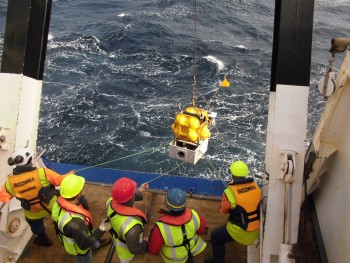 Scientists deploy an ocean bottom seismometer and absolute pressure gauge offshore Gisborne, New Zealand from the R/V Tangaroa. Photo credit: Takeo Yagi, University of Tokyo.