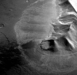 Perspective view of a mountain in the eastern Hellas region of Mars surrounded by a lobate deposit with flow textures on the surface. Recent measurements from the Mars Reconnaissance Orbiter SHARAD radar sounder have detected large amounts of water ice in similar deposits, arguing for the flow of glacial-like structures on Mars in the relatively recent geologic past. This suggests that snow and ice accumulated on the slope face and flowed viscously over the neighboring plains and is now protected from sublimation by a layer of rock debris and dust. Image is 31 km (20 miles) across. Topographic data shown here was acquired by the High Resolution Stereo Camera (HRSC) on the Mars Express spacecraft and is courtesy of ESA/DLR/FU Berlin.