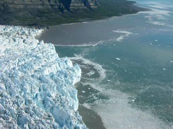The brown water at the top of the picture is the subglacial discharge, or meltwater, that has flowed through Alaska's Yahtse Glacier and into the ocean. Scientists at The University of Texas at Austin have pioneered a method to track meltwater flowing through glaciers that end in the ocean.