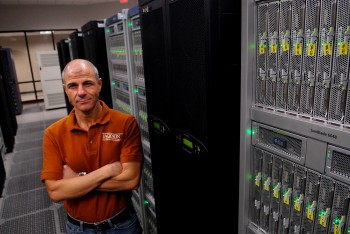 Omar Ghattas with super computing processors at the Texas Advanced Computing Center.