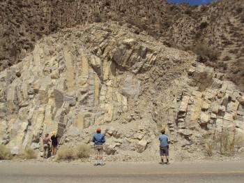 Students examine a rock formation. Photo courtesy of Brian Horton.