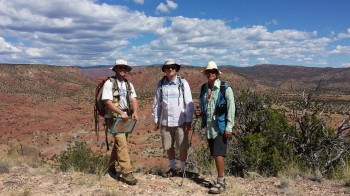 Joel Saylor (University of Houston), Brian Horton (Jackson school), and Mike Murphy (U of H) stand above the Espanola basin in the New Mexico desert. Lily Jackson.