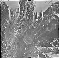 Rock-covered glaciers in Antarctica contain very old, slow-moving ice protected by a layer of rocky debris, similar to the newly revealed features on Mars. Credit: USGS.