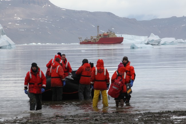 Researchers disembark on Antarctica during an expedition in 2011.
