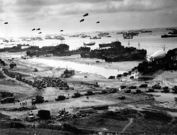LSTs (Landing Ship Tanks), landing vehicles, and cargo on a Normandy beach, June 1944. Source: U.S. Navy.