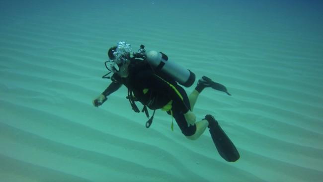 Chris Zahm floats over rippled shelf margin skeletal sands