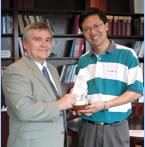 Liang Yang receives the 2007 Walter Award from Dean Barron