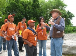 Petroleum geologist Pete Rose (right) told students about the geological history of the park.