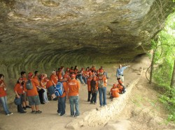 Geologist Chock Woodruff showed students a rock shelter once inhabited by Native Americans.