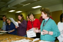 Hilary Olson (right), co-principal investigator for TXESS Revolution, shows teachers how to interpret geologic core samples at the Austin Core Research Center.