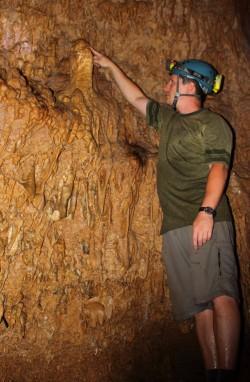 Partin Inspects a Stalagmite in Taurius Cave, Vanuatu