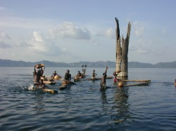 Boys from nearby villages practice traditional fishing methods on Lake Bosumtwi. Large tropical trees submerged in 15-20 meters of water provide evidence that severe, long-lasting droughts occurred just a few centuries ago. Photo by J.T. Overpeck and W. Wheeler.