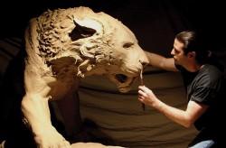 Artist John Maisano sculpting Smilodon from clay. John Maisano.