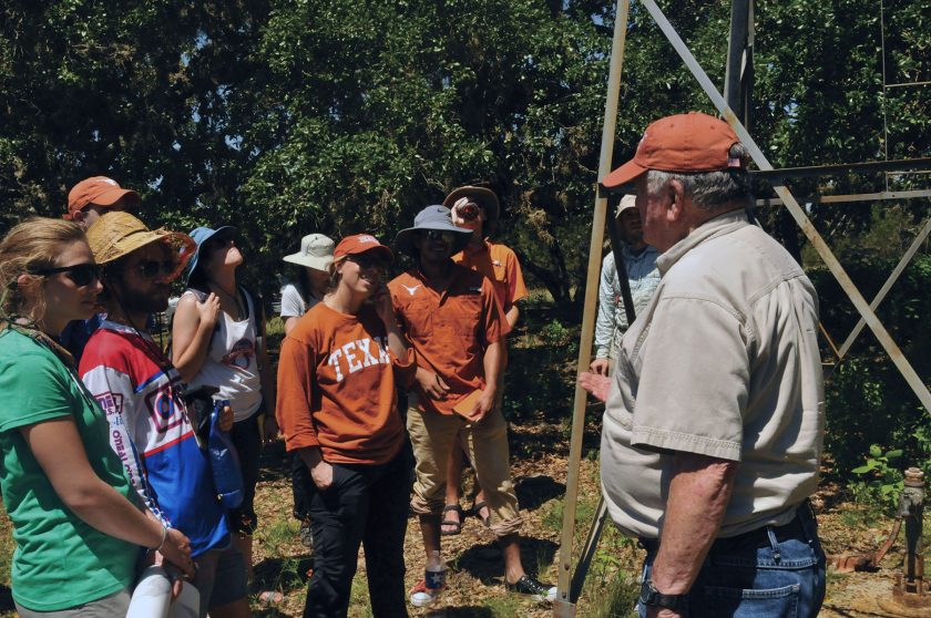 White speaking to the hydrology field camp.