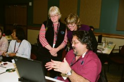 Marsha Willis (left), professional development coordinator for Texas Regional Collaboratives, and Kathy Ellins (center), TXESS Revolution lead principal investigator, discuss geological cores with a teacher.