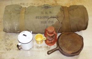 bedroll, lantern, coffee pot, bean pot