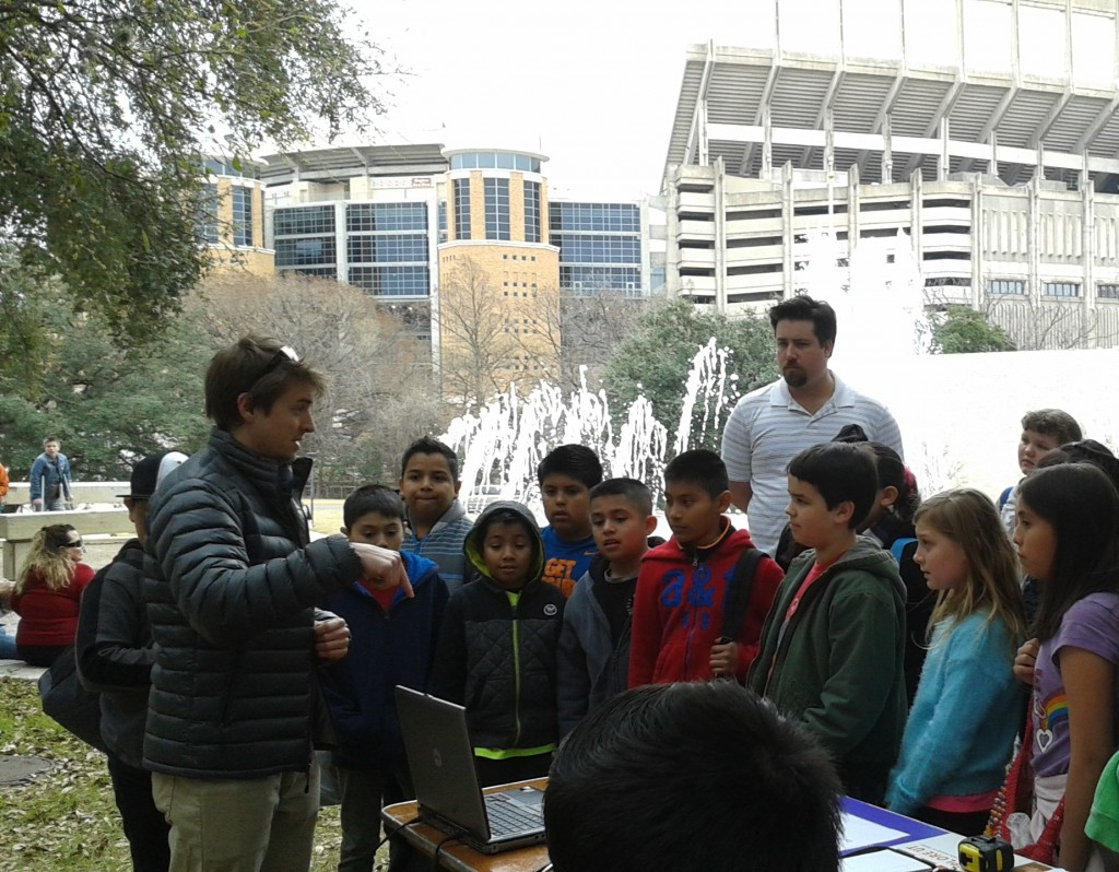 "Student explaining ""The Sound of Rocks"" at Explore UT"