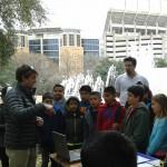 "Student explaining ""The Sound of Rocks"" at Explore UT"