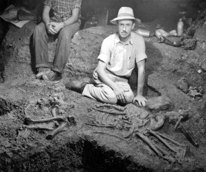 Grayson Meade with Scimitar-toothed cat specimen in Friesenhahn Cave